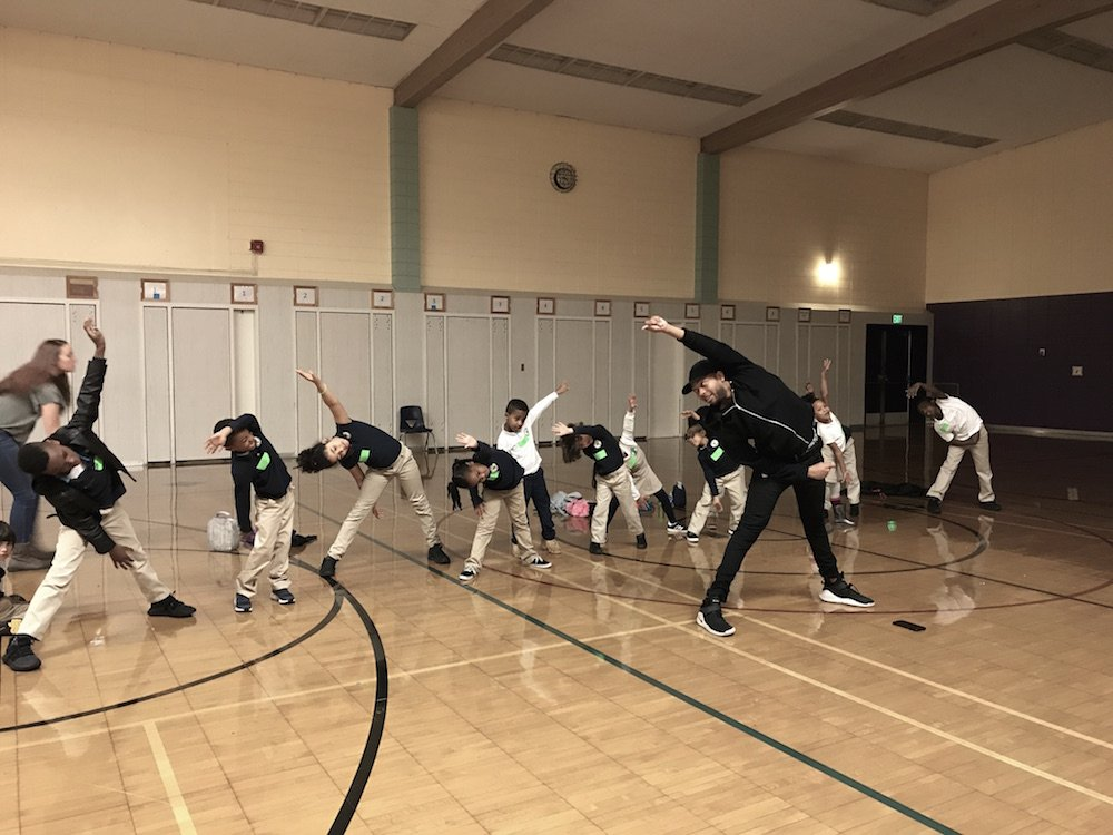 young kids doing creative movement in a gym