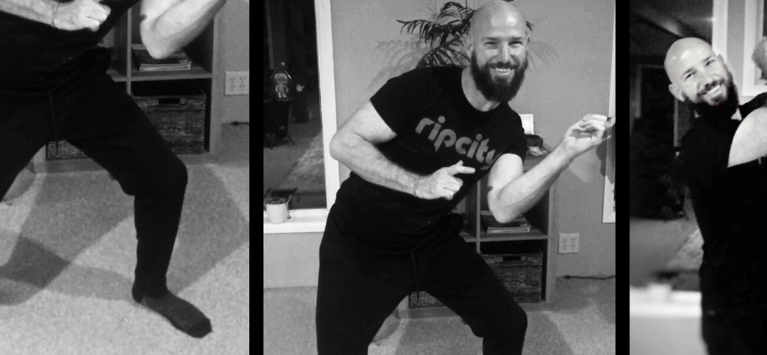 images of man dancing in living room in socks