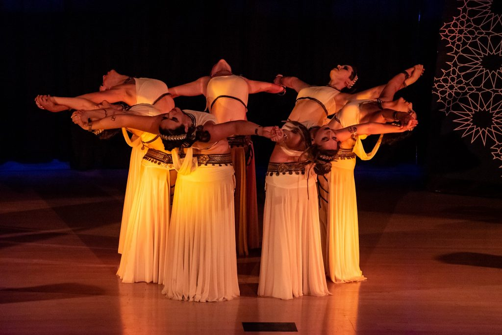 eight women in a circle doing a backbend