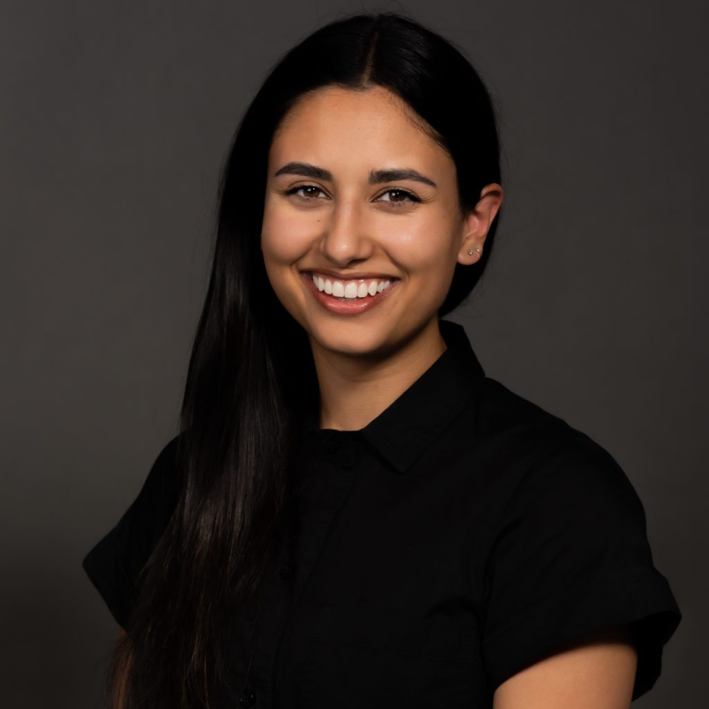 image of smiling dark haired woman with black top