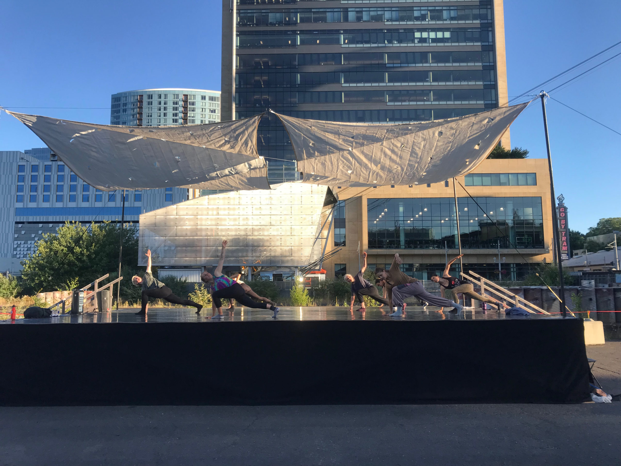 image of outdoor stage with dancers on it