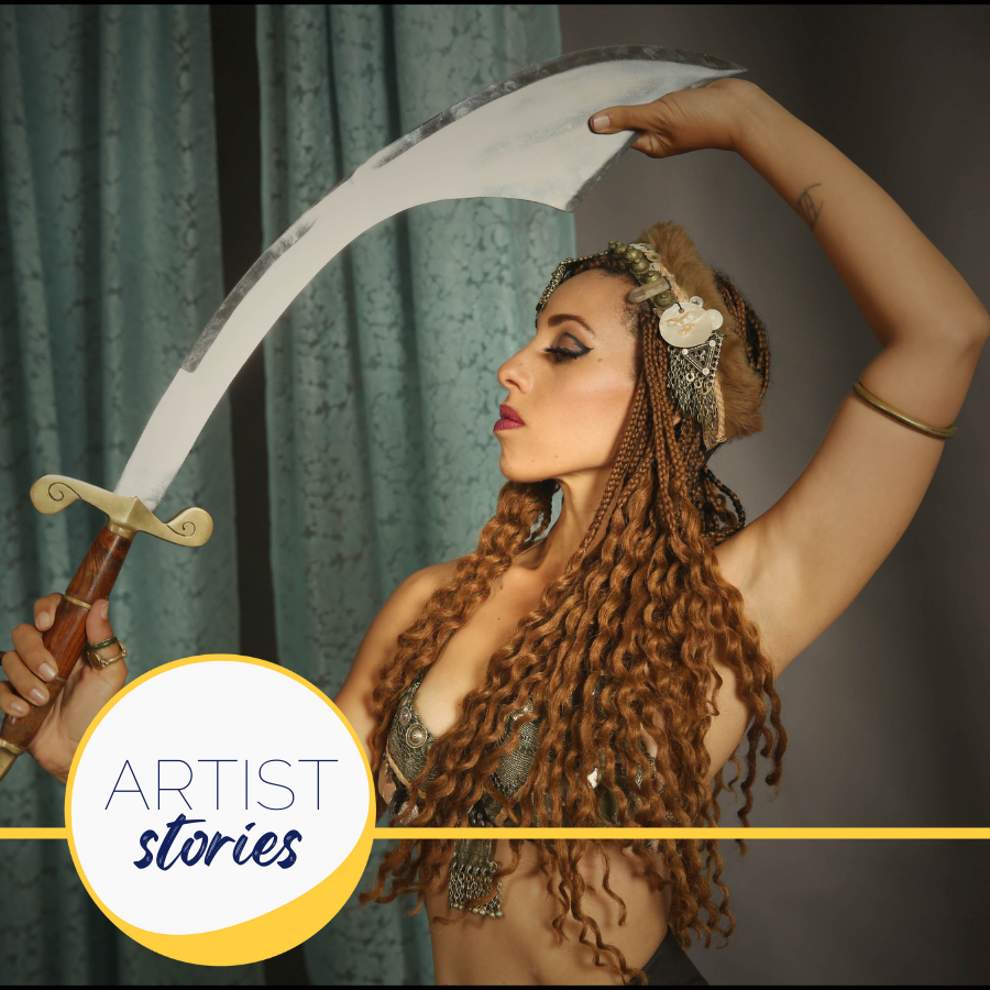 woman in transcultural fusion costume holding a sword