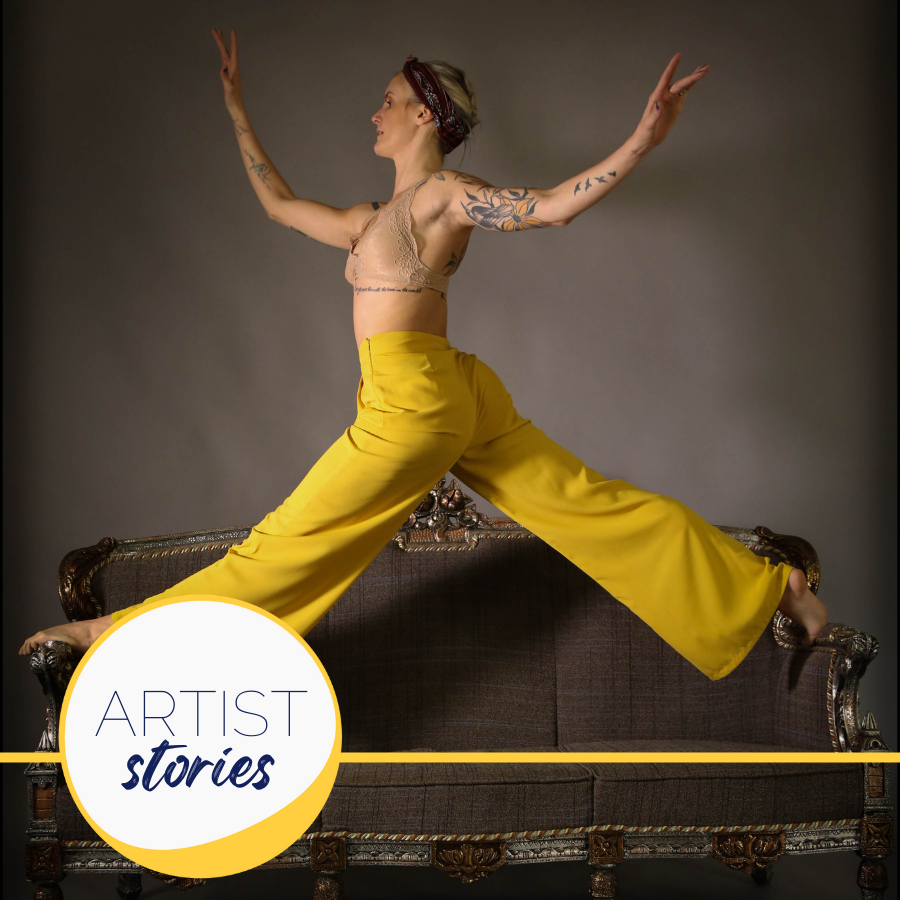 woman in yellow pants doing the splits on a couch