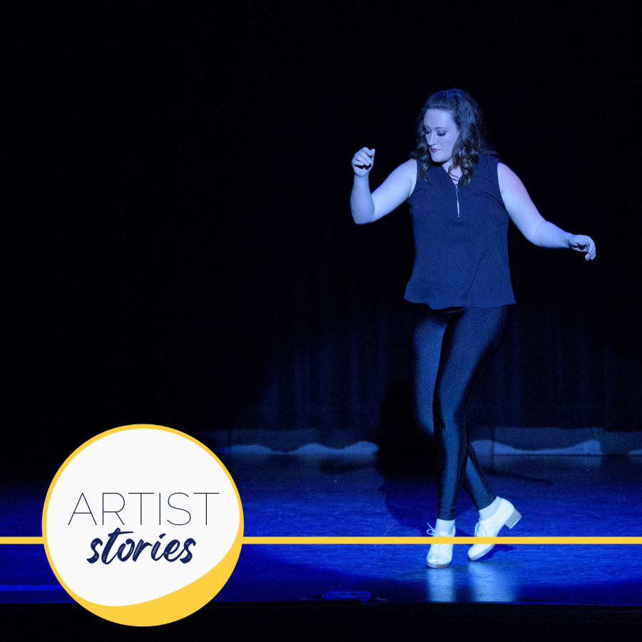 woman tap dancing on black background with blue lighting
