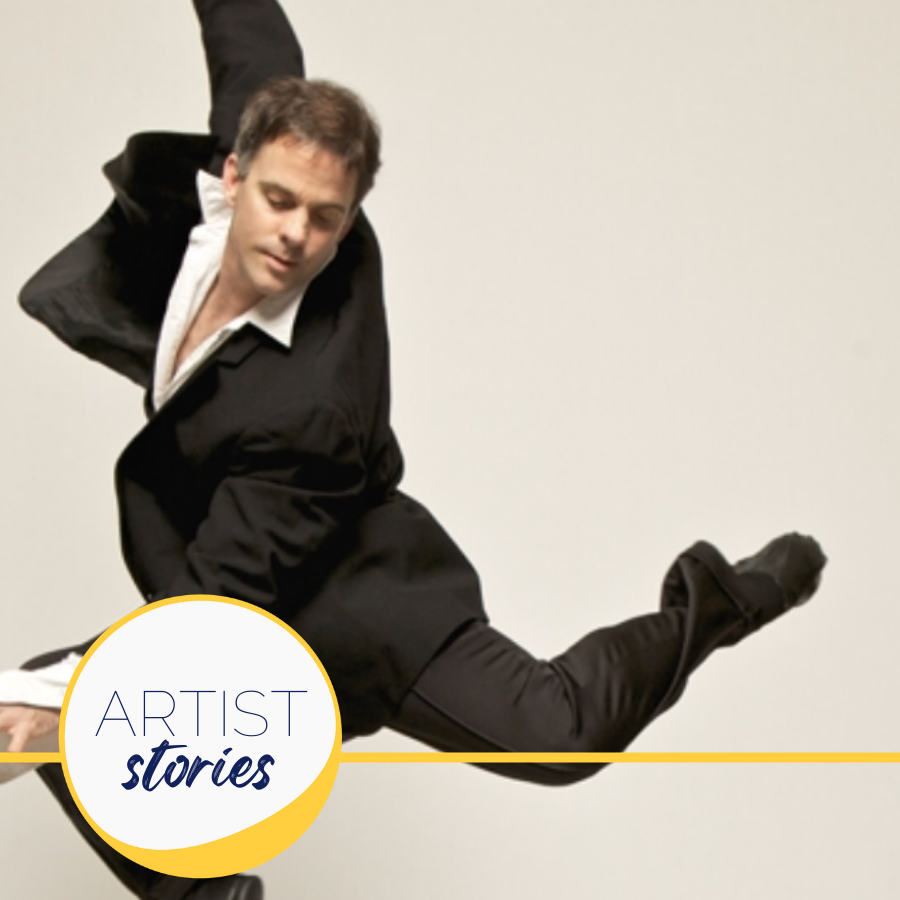 man in suit doing a ballet jump